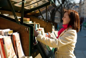 4447416-beautiful-woman-in-paris-selecting-a-book-in-an-outdoor-bookseller-box
